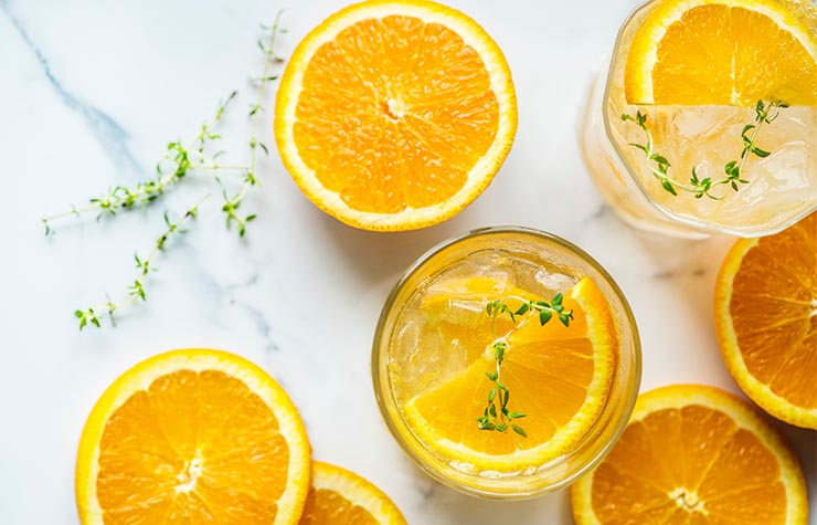 Fizzy glass of orange infused water