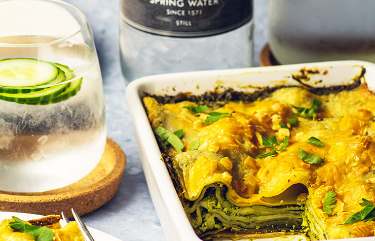 Vegan Kale lasagne with glass of harrogate spring water