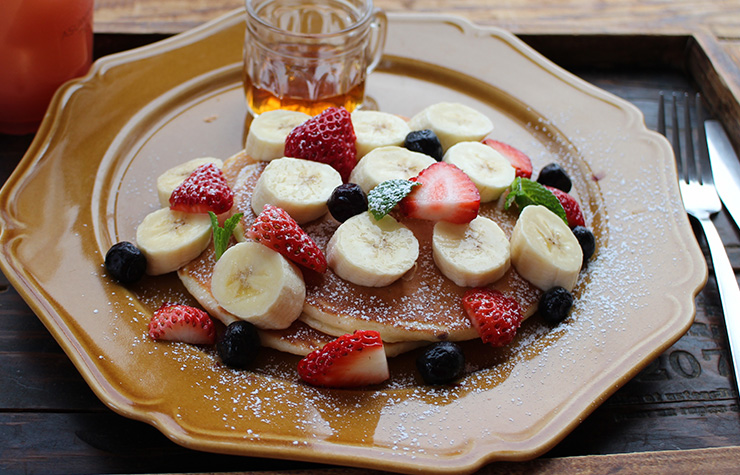 Plate of sparkling water pancakes with strawberries and banana