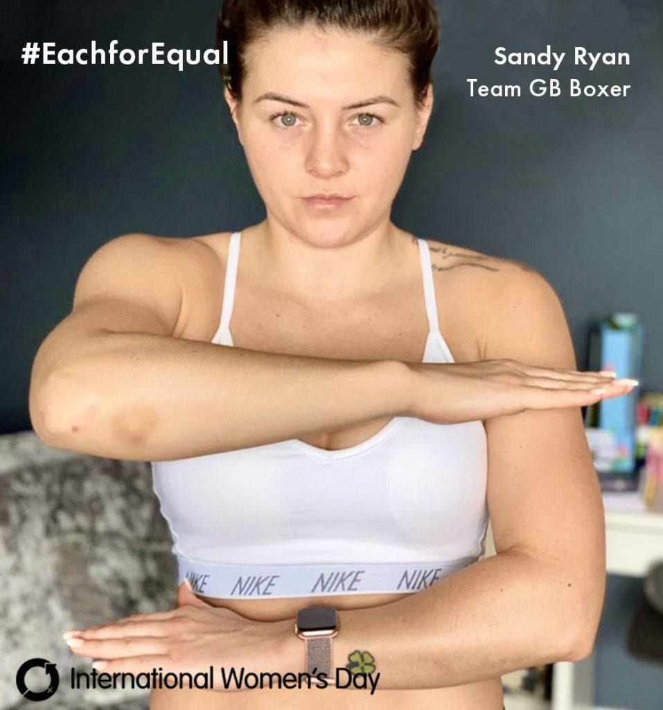 Female Boxer posing for Each for Equal campaign