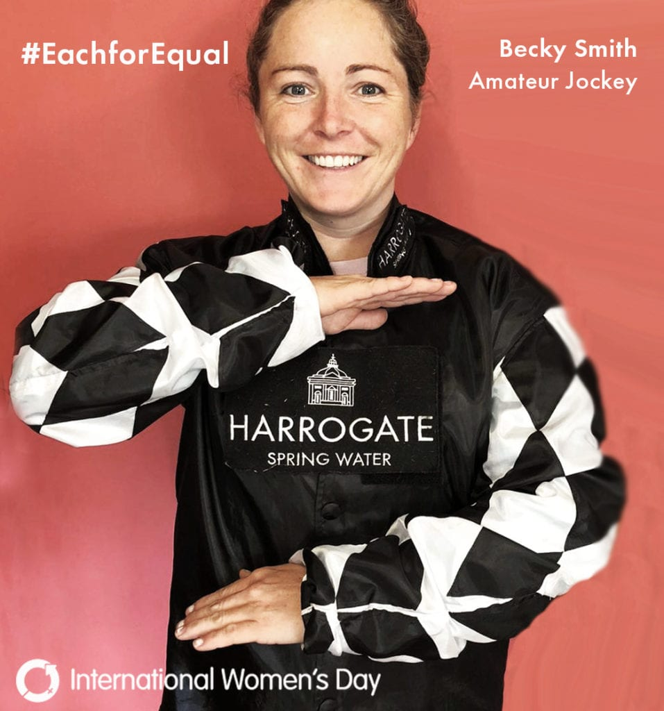 female jockey posing for each for equal campaign for international women's day